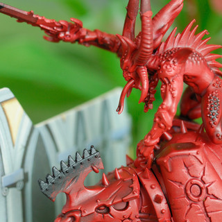 Closeup of a Bloodcrasher of Khorne and a ruined building
