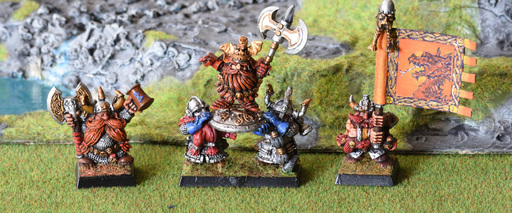Dwarf command group including a lord on shieldbearers, army standard bearer and a thane (Joseph Bugman)